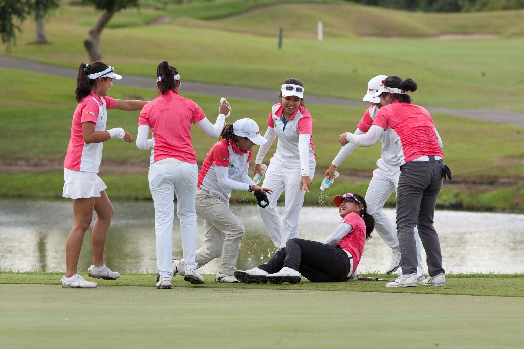 Princess Superal (on the ground) gets a douse of water from ICTSI teammates as they celebrate her victory in the ICTSI Sherwood Ladies Championship.