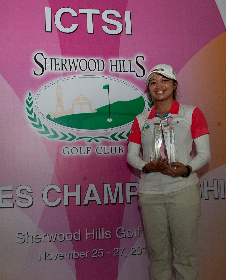 Amateur Princess Superal holds her twin trophies after winning the low amateur honors and the ICTSI Sherwood Ladies Championship with a two-stroke victory over pro Cyna Rodriguez.
