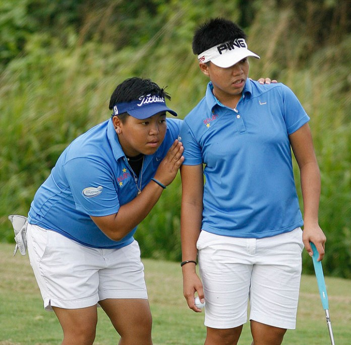 Chihiro Ikeda (left) gives South teammate Sarah Ababa some advice on the line of her putt on No. 12 during their clash with North's Heidi Chua and Jan Punzalan in the ICTSI LPGT Duel 2 at South Links.
