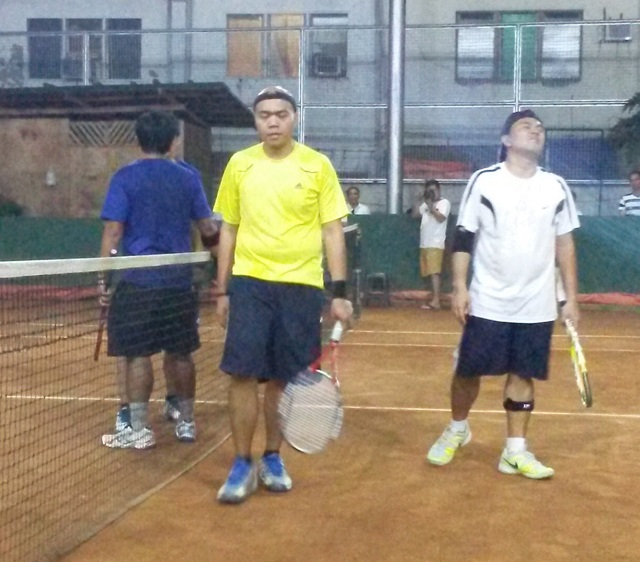 The Tagum pair of Julius Cesar Anas (in yellow) and Noel Gastones walk away dejected after losing the title.