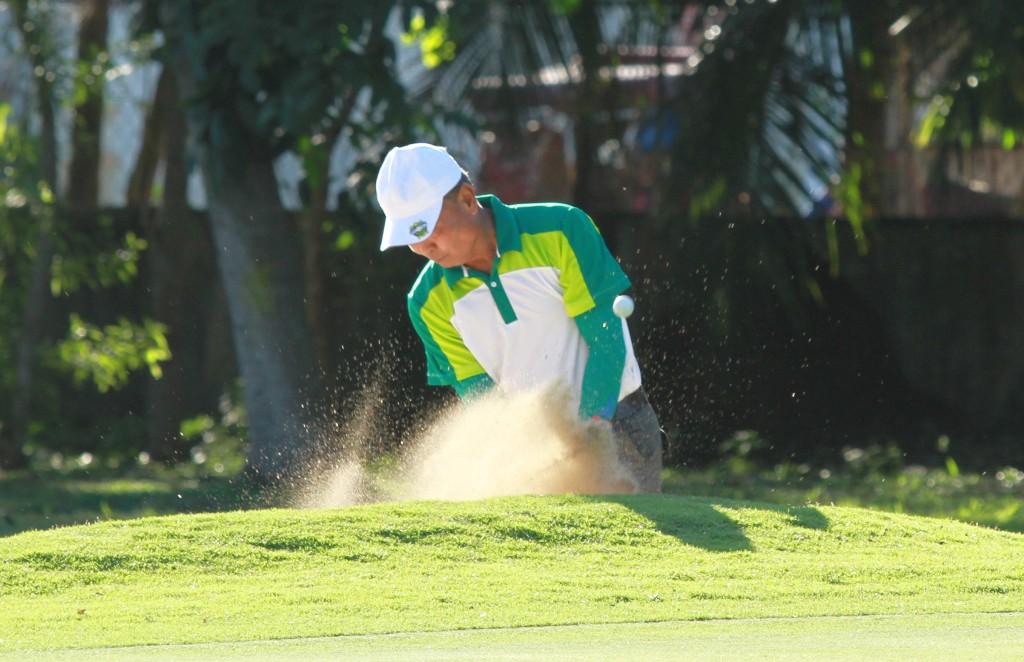 Alta Vista skipper Razy Razon blasts out of a bunker on hole No. 17 in Mactan Island Golf Club.
