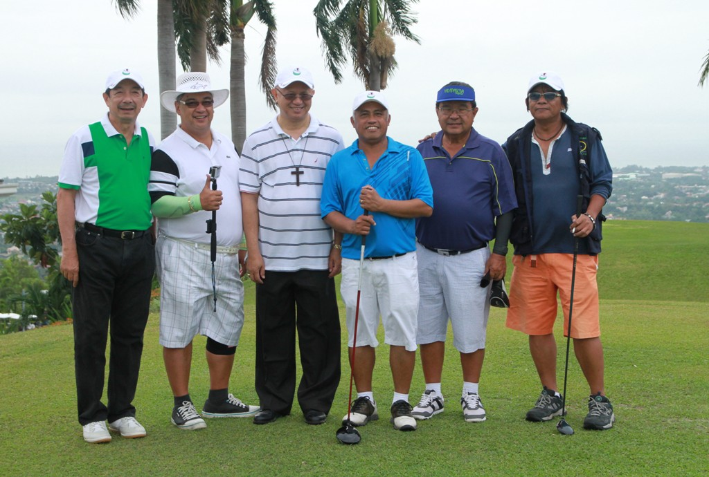 Participants and organizers pose for a souvenir after the ceremonial tee off.  They are (from left) AVGCC Director Vicente Go, Mel Alejandro, Archbishop Jose Palma, Fr. Bobby Ebisa, Henry Casuga, and Alex Bolongaita.