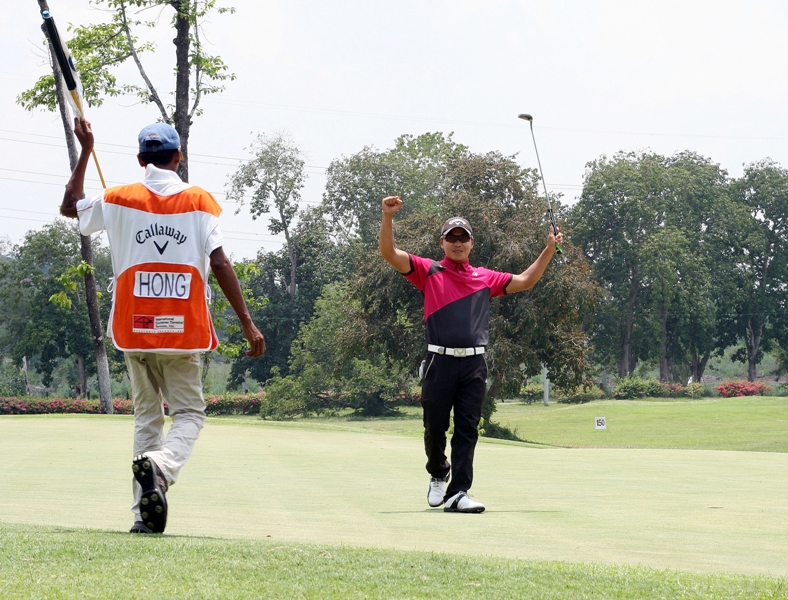 Charles Hong raises his arms in triumph after closing out with a routine par for a two-stroke win in the ICTSI Luisita Championship.