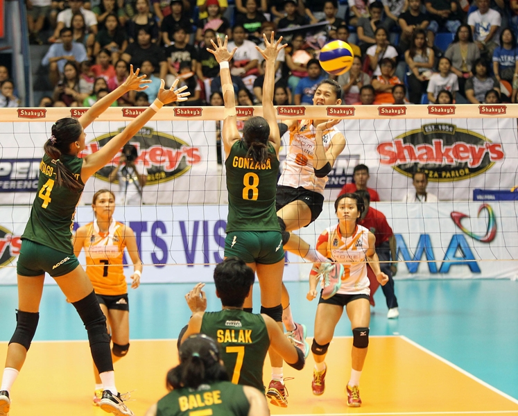 PLDT's chief blocker Jaja Santiago flaunts her spiking prowess as she blasted in one against Army's Jovelyn Gonzaga as sister Dindin Santiago-Manabat tries to provide help in Game Two of their Shakey's V-League Season 12 Open Conference title clash at The Arena in San Juan. The Ultra Fast Spikers won in four to force a sudden death.
