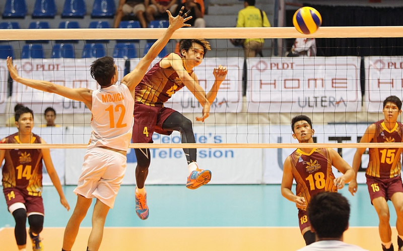 Cagayan's Peter Torres hammers in a kill against PLDT's Howard Mojica during the preview of the Spikers' Turf finals at The Arena.
