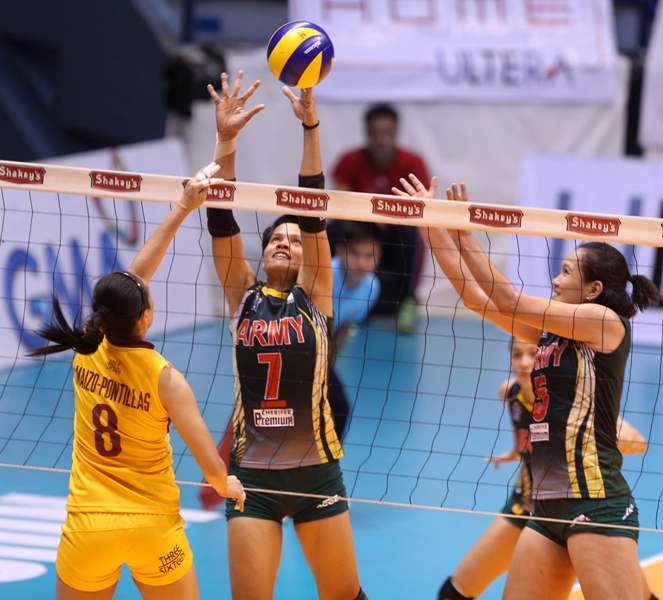Army's ace setter Tina Salak (7) foils Cagayan Valley's Aiza Maizo-Pontillas' tip as Lady Trooper Mary Jean Balse tries to provide help during their showdown for the second finals berth in the Shakey's V-League Season 12 Open Conference at The Arena in San Juan.