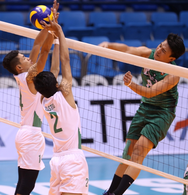 St, Benilde's Jethro Orian (right) hammers in a kill against La Salle-Dasmariñas' Aidam Adam and Bryan Castro during their Spikers' Turf Collegiate Conference clash at The Arena in San Juan.