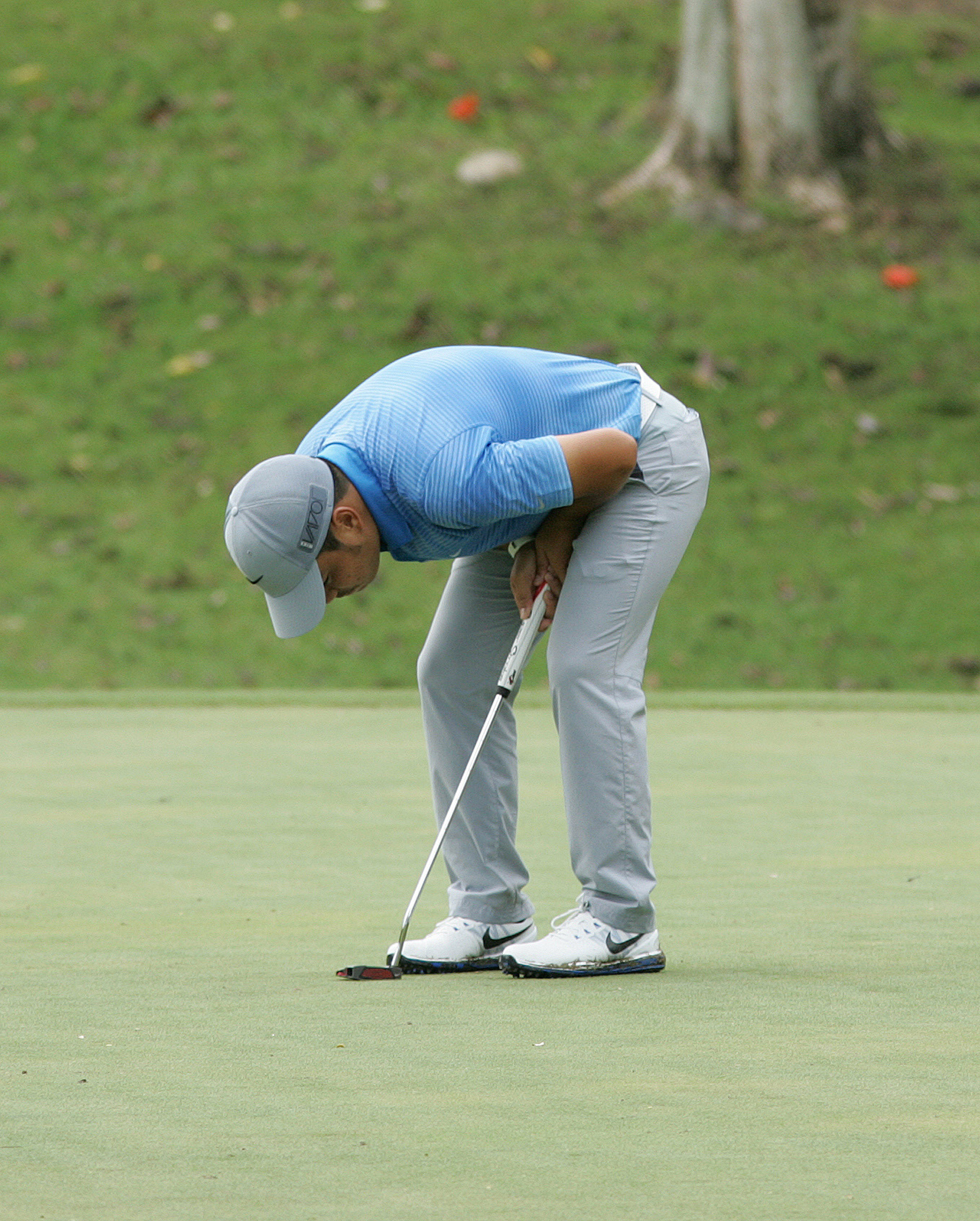 Miguel Tabuena reacts after flubbing an eagle-putt on the par-5 No. 5.