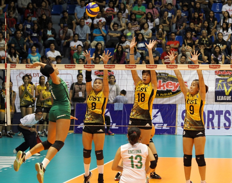 St. Benilde's Jannine Navarro (left) soars for an attack against UST's Carmela Tunay (8), Marivic Meneses (18) and Ennajie Laure (9) during their Shakey's V-League encounter at The Arena.