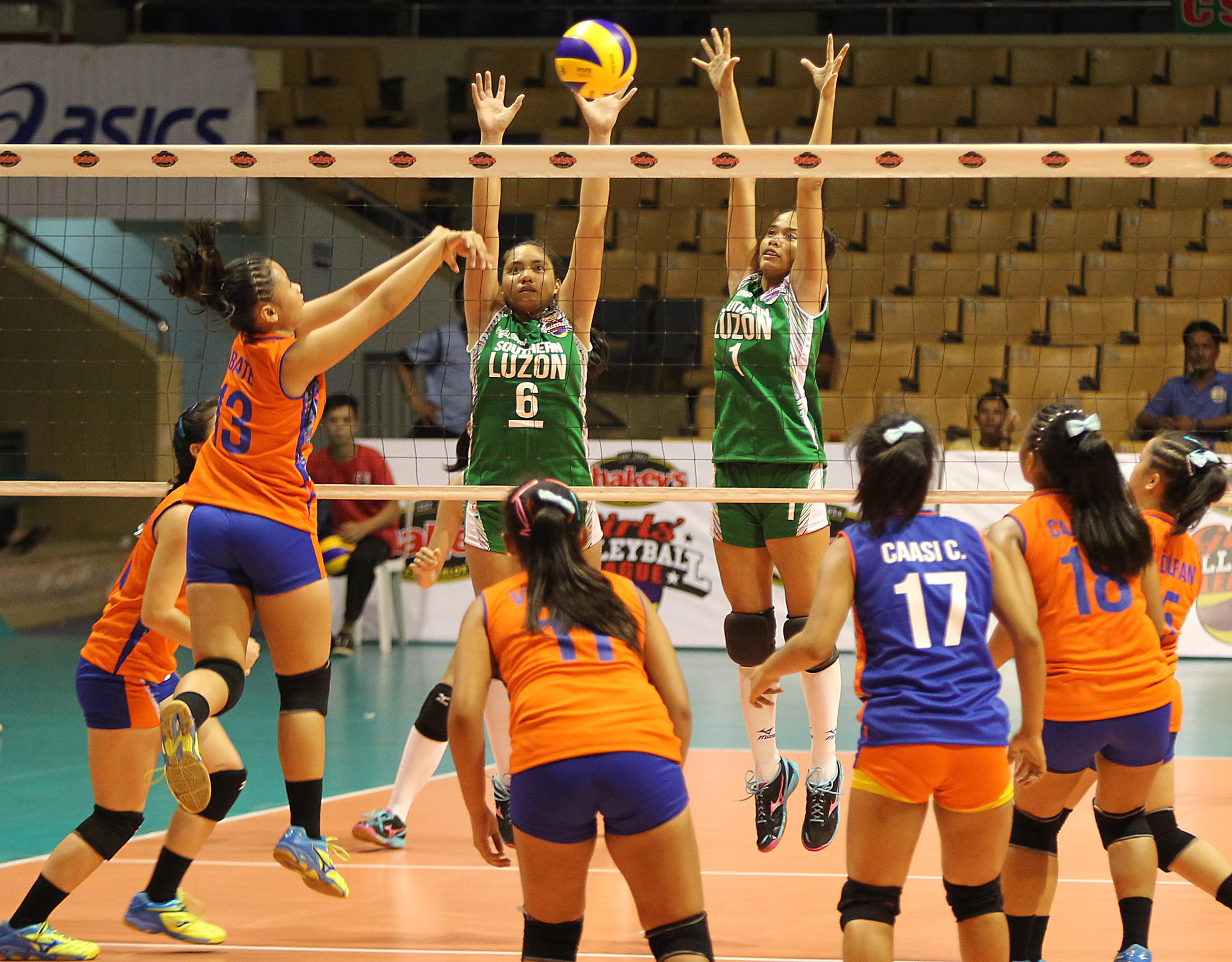 Central Visayas' Janzel Bate (13) scores over the outstretched arms of Southern Luzon's Janel Maraguinot and Jewel Encarnacion during the opener of the Shakey's Girls' Volleyball League national finals at the Astrodome last Monday.