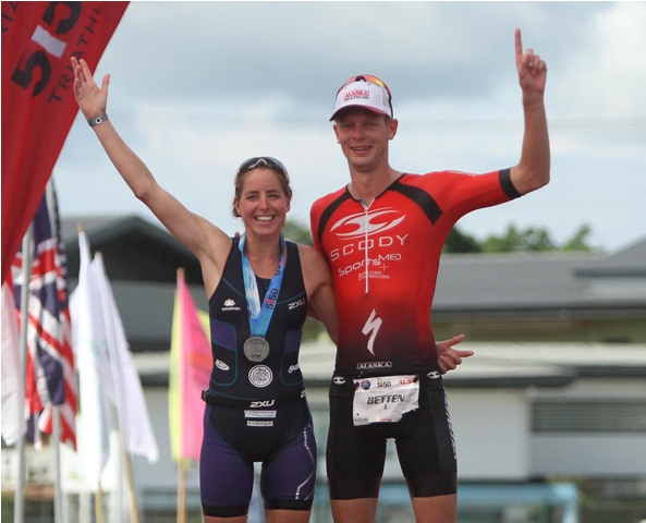 Sam Betten of Australia and Kiwi Amelia Watkinson pose after ruling their respective sides in wire-to-wire fashions in the 2016 Regent 5150 Triathlon in Subic yesterday.