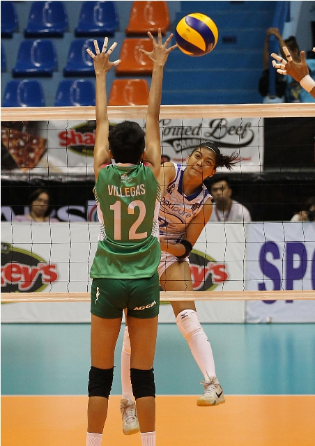 BaliPure top hitter Alyssa Valdez goes one-on-one versus Katherine Villegas of Team Laoag and came away with a power hit during their Shakey's V-League showdown.