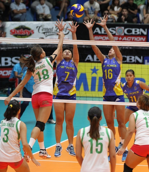 Laoag's Jovielyn Prado (18) defies Air Force blockers Wendy Semana (7) and Angel Antipuesto and scores on a looper during Game One of their best-of-three semifinal series in the Shakey's V-League.