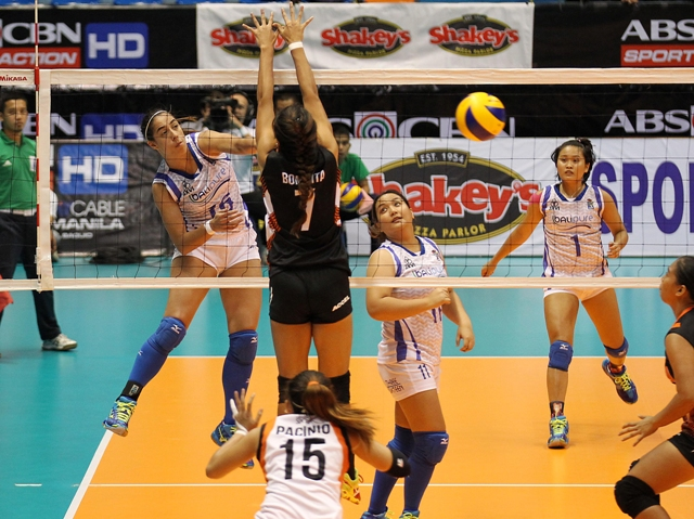 BaliPure's Amy Ahomiro (left) beats Team Iriga's Grazielle Bombita in a one-on-one duel upfront, scoring on a kill during their Shakey's V-League clash yesterday.