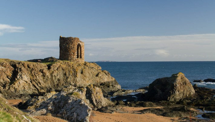 Lady's Tower, Elie, Fife, Scotland. A stone tower on the coastal path. Perched on the rocks with the sea below