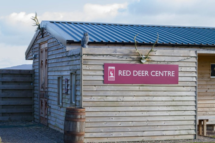 "Highland Safaris, Perthshire. Wooden building with a sign reading ""Red Deer Centre"""