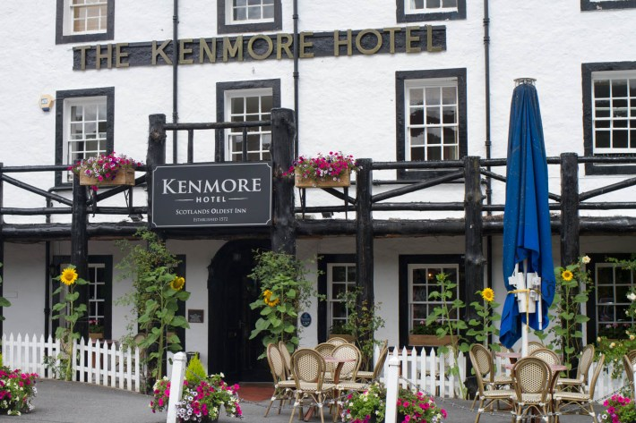 Kenmore Hotel, Perthshire. Black and white building with tables and chairs outside