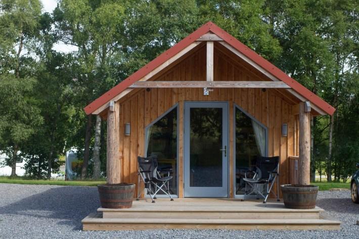 Fog Pod, Glamping, Braemar. Wooden camping pod on campsite