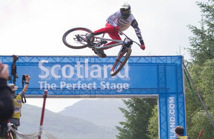 A mountain bike jumping, at the Fort William World Mountain Bike Championships