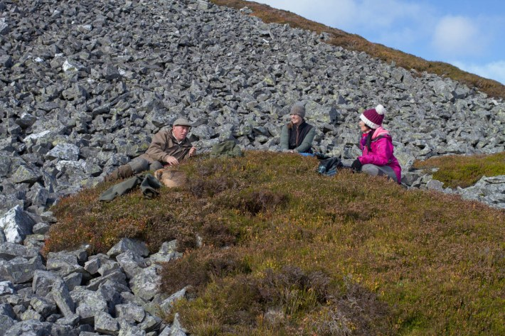 Glenesk Wildlife tours, Scotland. Three people and a dog sat on the heather hills
