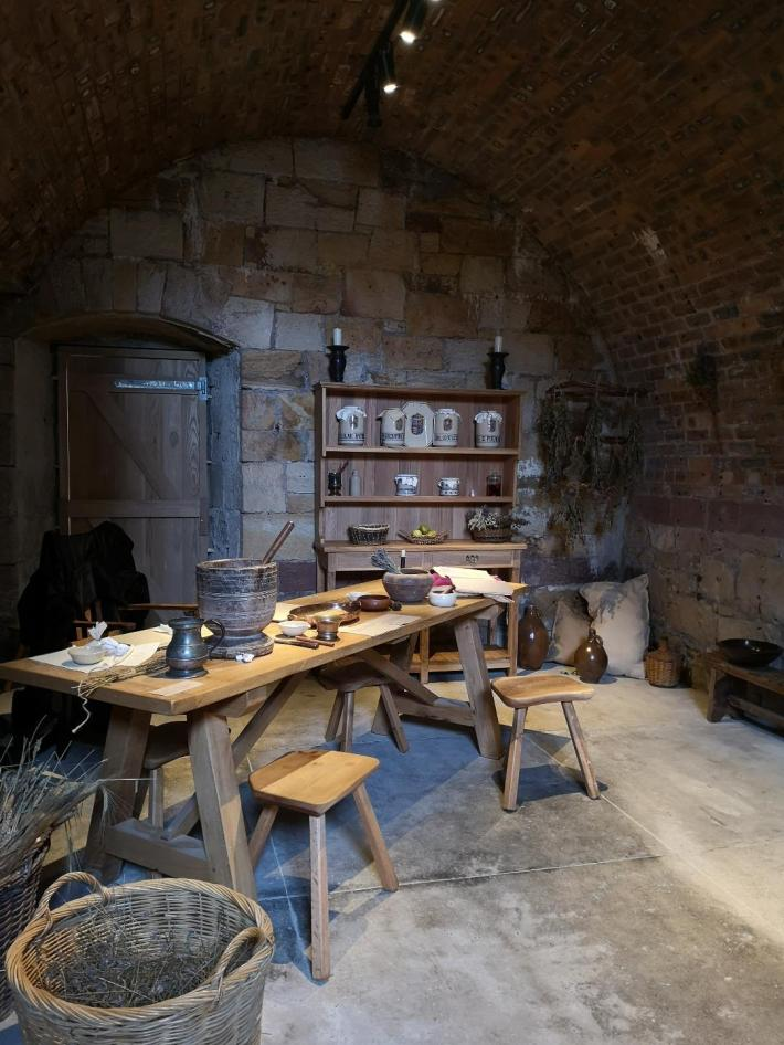 Apothecary in the cellars of Falkland Palace. Wooden bench with utensils on