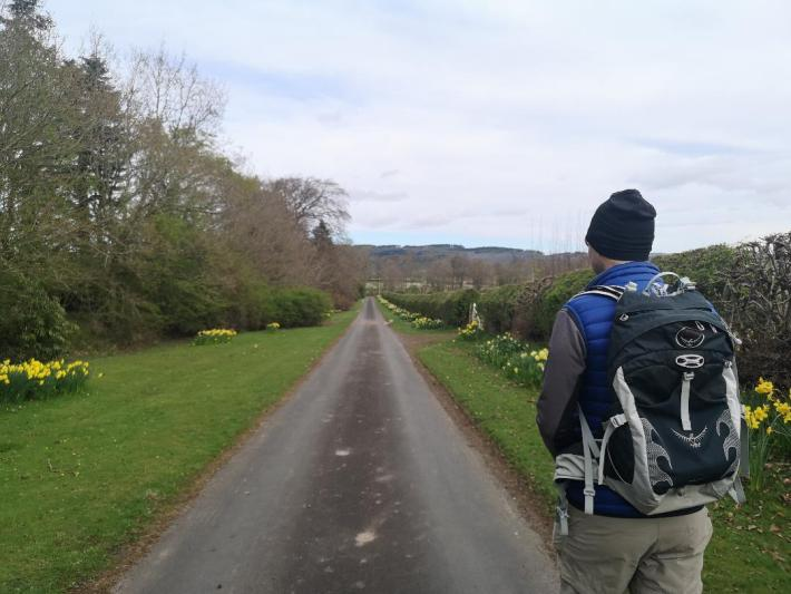 A man out walking wearing a backpack in Scotland - little walks from home during lockdown