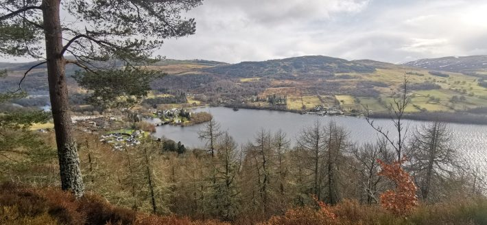 Image of: The view from Black Rock viewpoint, Perthshire. Looking down toward the village of Kenmore with loch Tay cutting through the centre of the image.