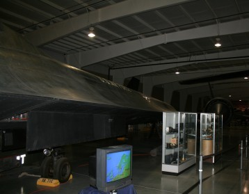 I took 20 pictures of the SR-71 and this is the only one that turned out at all.  It is still in stealth mode even in the hanger, Dull black, not enough flash to light it up.  A remarkable machine.