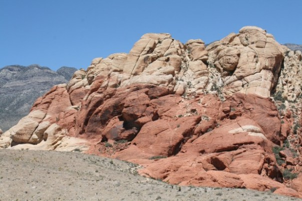 There are small outcroppings of white and red rock.