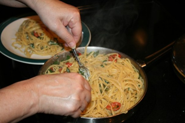 In olive oil, sauteed onion, garlic, green beans, tomatoes, cooked linguine, basil, and parsley, Edie did great.  It was so good.
