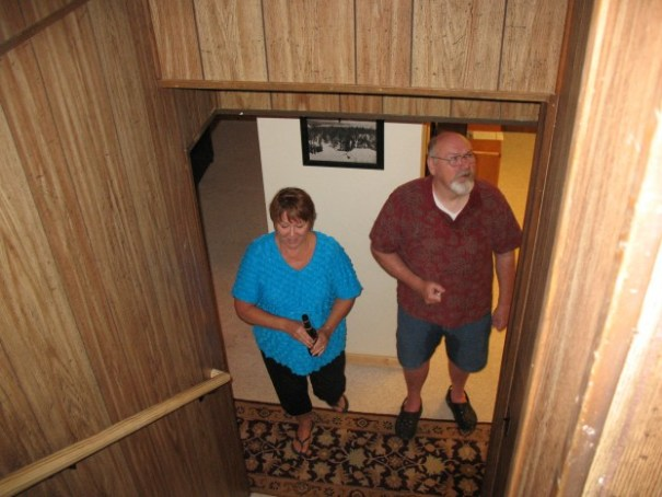 Sharon coming upstairs with a grumpy old man, who had been rafting, thus wet pants.