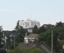 Appears to be a house with a small observatory, all sitting on a single pillar.
