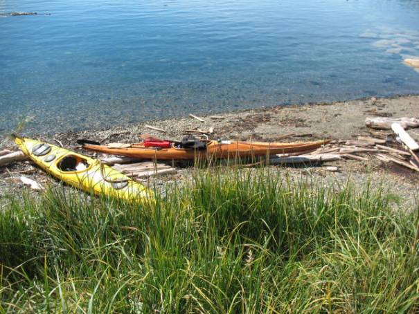 Two island visitors off eating lunch.  Left their kayaks on the beach.