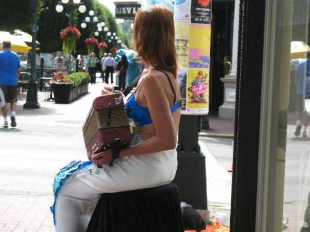 Street performer resting.