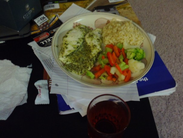 A glass of wine, rice, veggies and pesto sauce tilapia, Edie did good.
