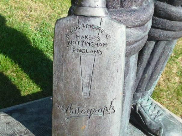 Statue detail on Cricket bat.