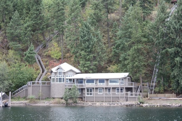 Lots of beautiful lake side homes.  Note stairs on left going up to street level and rails on right for Hill-o-vator.