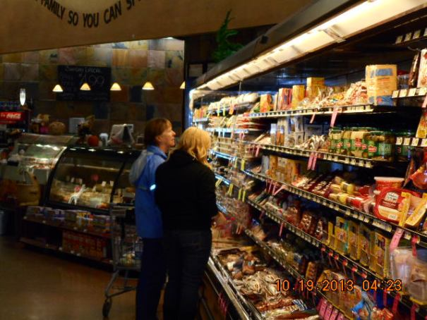 Pretty woman and her daughter shopping for grub to take back to the resort.