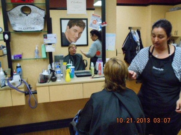 Pretty woman getting her hair cut.