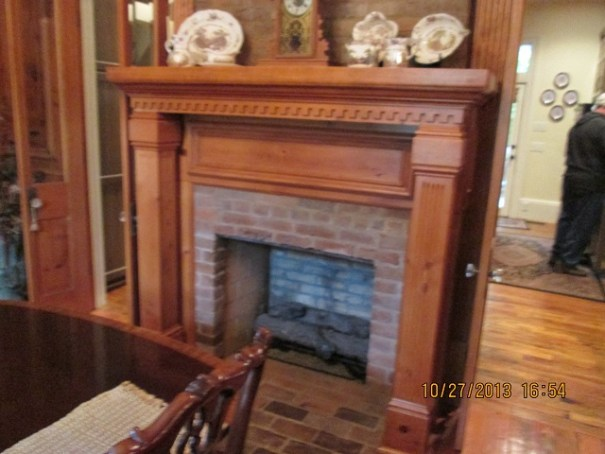 Dining room fireplace, one of five in the house.