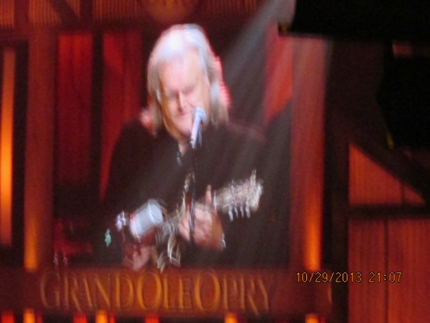 Ricky Skaggs playing the mandolin so fast he is a blur.