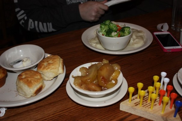 Lex had chicken and dumplings with mixed vegetables and fried apples.