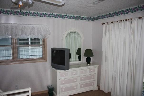 Bedroom TV and Dresser.