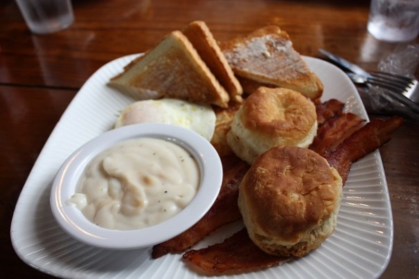 Lex didn't have breakfast before we left and opted for biscuits and gravy , bacon, hash browns, toast and an egg over easy.