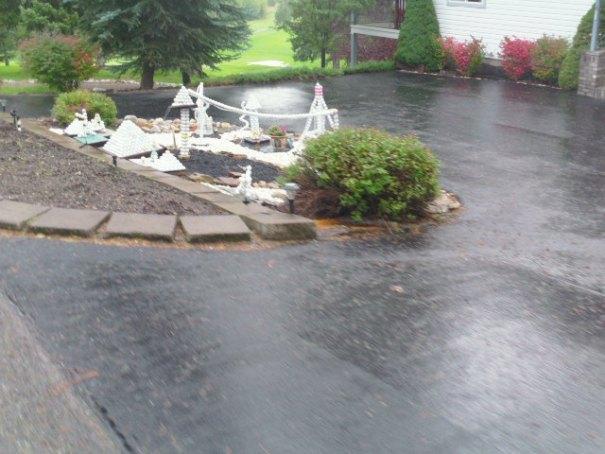 Golf ball art in their driveway.