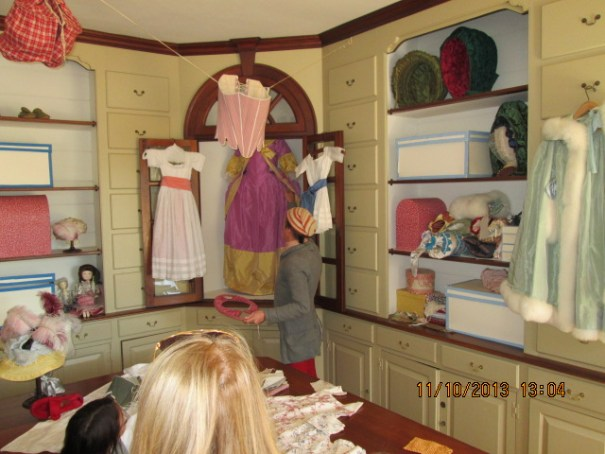 The purple apron-ed dress in the cabinet is the type that sits comfortably off the hips.