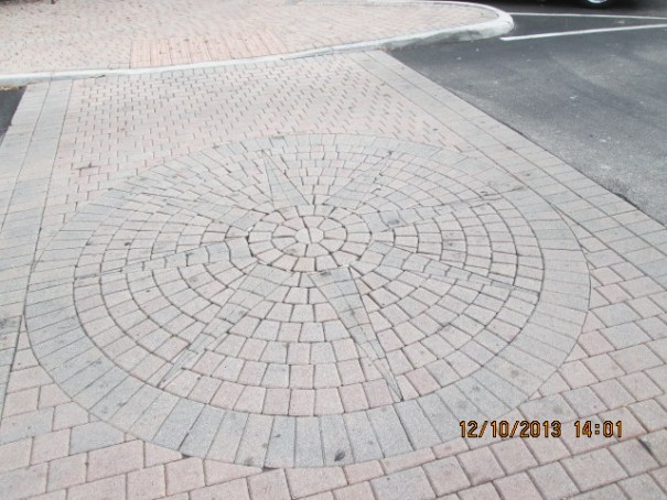 I did some paver work at our place, so I appreciate all the cuts needed to make straight things look curved.  The Town Center is full of circles and compass rose patterns.