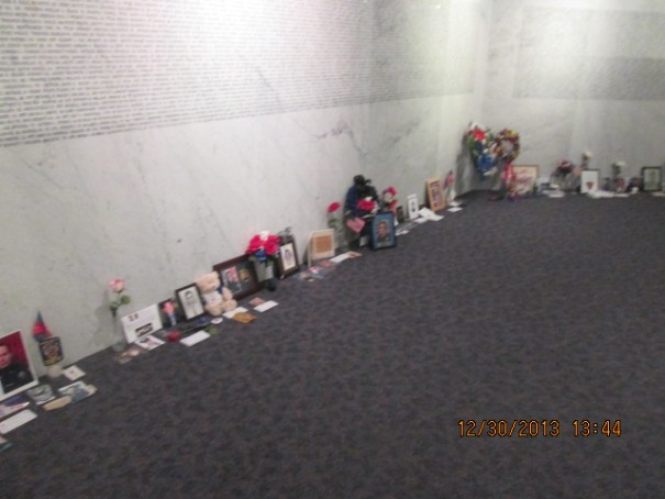 Personal memorials line almost every spot along the walls.