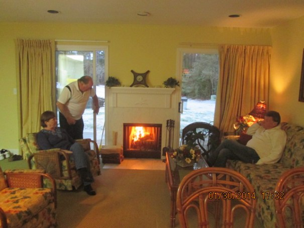 Wood burning fireplace, feed by Skinner with Edie and Gary watching.