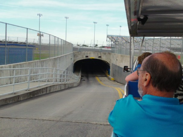 Vehicle tunnel entrance under the track.